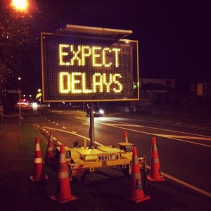 expect delays road sign night